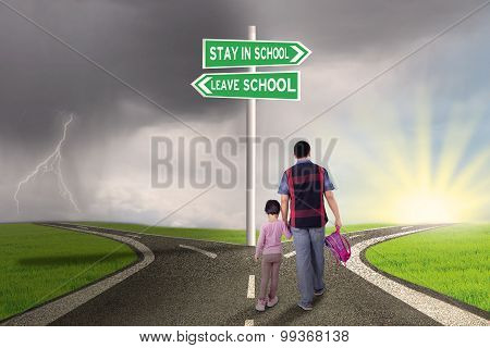 Dad And Child Walking On The Road To School