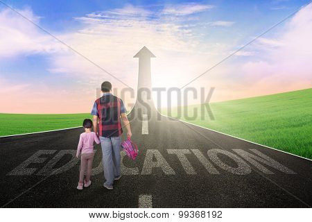 Dad And Child Walking On The Street With Arrow
