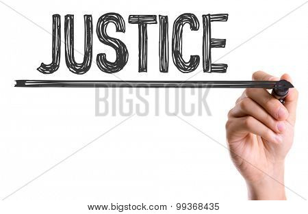Hand with marker writing the word Justice