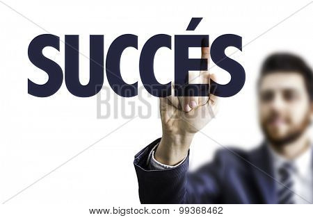Business man pointing the text: Success (in French)