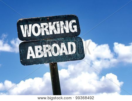 Working Abroad sign with sky background