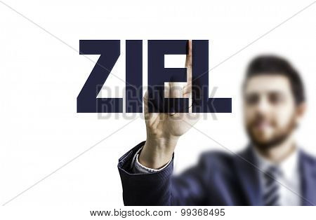 Business man pointing the text: Aim (in German)