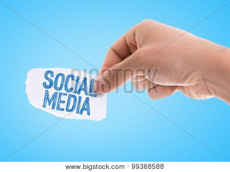 Piece of paper with the word Social Media with blue background