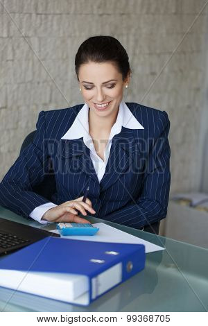 Accountant Calculating In Office With Teeth Smile