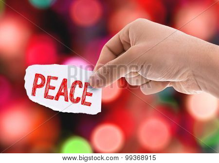 Piece of paper with the word Peace with bokeh background