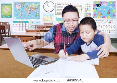 Young Teacher Guides His Student To Learn