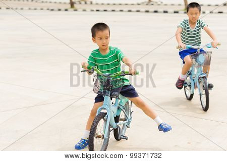 Boy Rid Bicycle