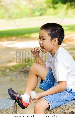 Boy Eating Stick Chicken