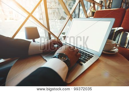 Silhouette Of Cropped Shot Of Handsome Businessman Using Notebook Computer With Blank Empty Screen F