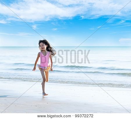 Little Asian Girl Run On The Beach