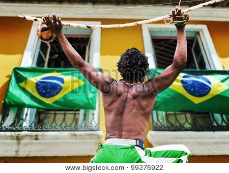 Brazilian performing Capoeira with Berimbau Instrument in Salvador, Bahia, Brazil.