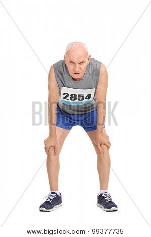 Full length portrait of an exhausted senior runner in sportswear isolated on white background