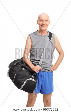 Vertical shot of a senior athlete carrying a black sports bag and looking at the camera isolated on white background