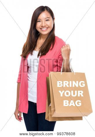 Happy woman with shopping bag and showing bring your bag