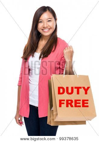 Happy woman with shopping bag and showing duty free