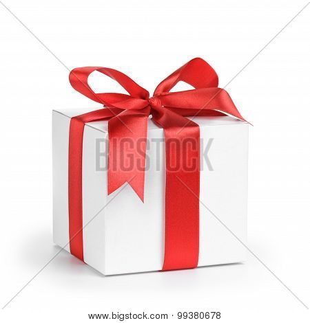 white present paper box with red ribbon bow