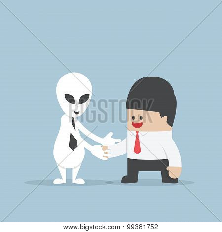 Businessman Shaking Hands With Alien