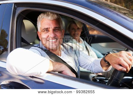 lovely middle aged couple driving a car