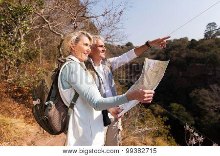 senior hiking couple on top of the mountain