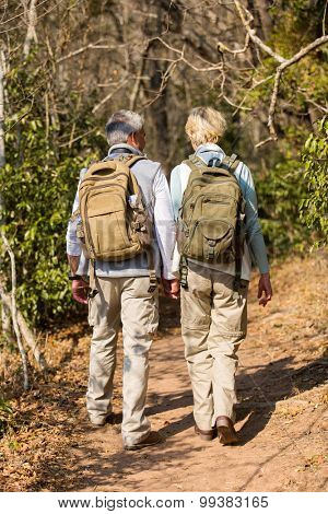 loving mid age couple hiking in forest