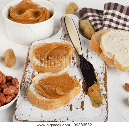 Toast With Peanut Butter  And Peanuts On Wooden Board