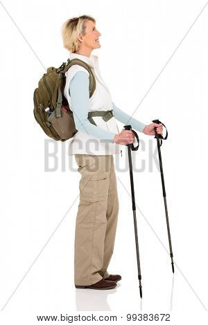 side view of happy middle aged hiker with trekking poles