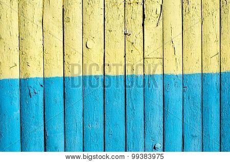 Ukraine flag painted on old wooden fence