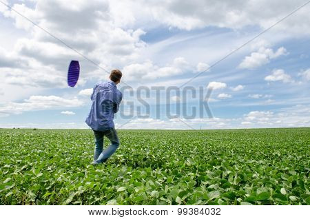 Free land kiting on green field with blue sky