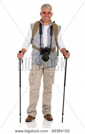 portrait of middle aged male hiker with camera