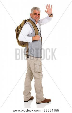 cheerful senior tourist waving goodbye isolated on white