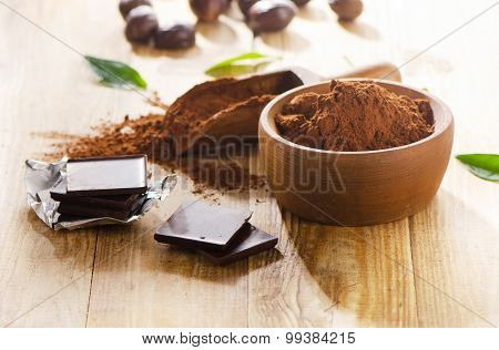 Chocolate Bars And A Bowl Of Cacao Powder.