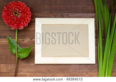 Empty Picture Frame On Wooden Background, Zinnia Flowers