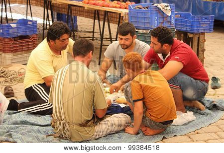 A group of turkish males having a break