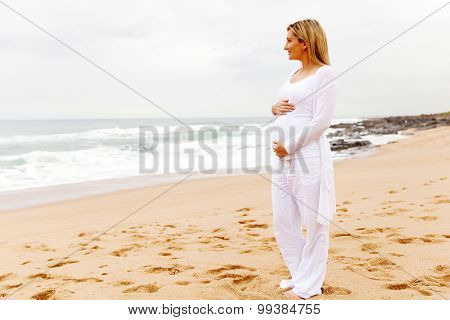 pregnant woman in casual clothes at the beach