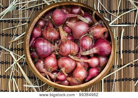 Purple Onion Pile On A Wooden Table