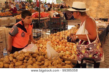 An english lady buying fresh market produce