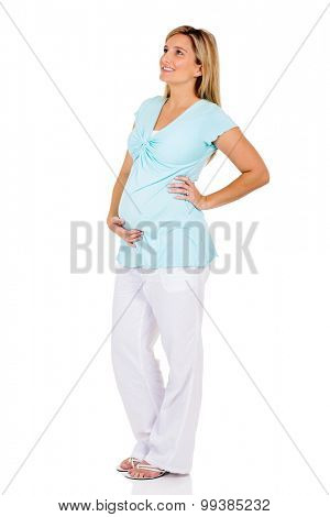side view of smiling pregnant woman looking up isolated on white