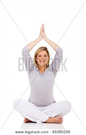 happy pregnant woman yoga meditating over white background