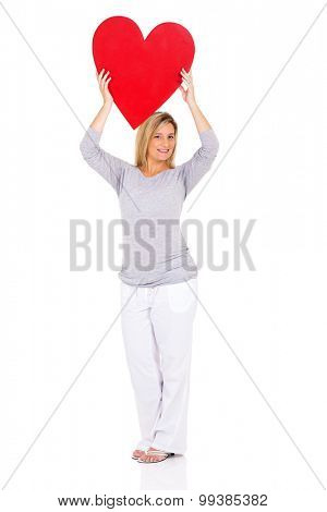 happy pregnant woman holding heart shape over white background
