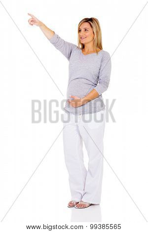 young pregnant woman pointing at empty space isolated on white background