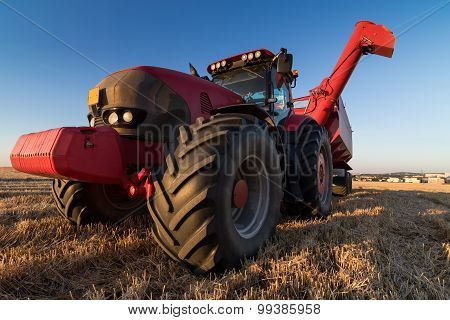 Agriculture Tractor At Stubble Field