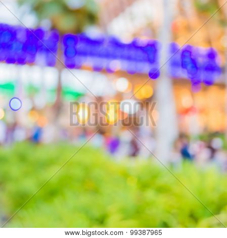 Blur Image Of People Sit On The Table With Festival Bokeh Lights.