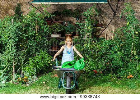 Cute Little Girl Gardening In The Backyard