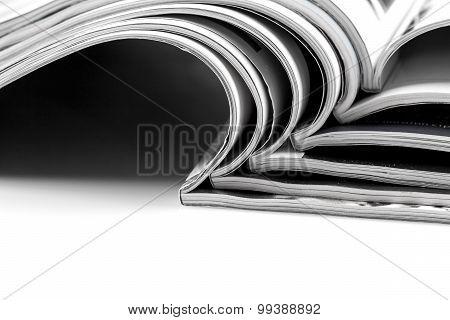 Stack Of Magazines On White Background