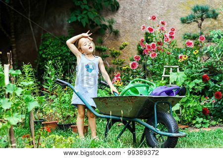 Cute Little Girl Gardening In The Backyard