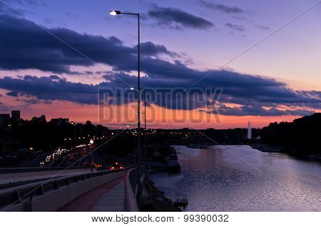 Traffic and city lights by the river Sava at twilight in Belgrade
