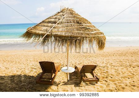 The Beach chairs and umbrella on a beautiful panoramic beach