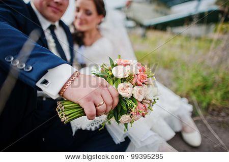 Wedding Bouquet At Hand Of Groom