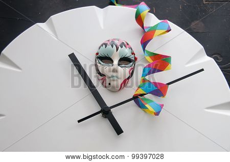 Carnival Mask On Clock Showing Eleven Minutes After Eleven