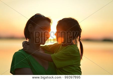 Little  girl with  mother near the sea